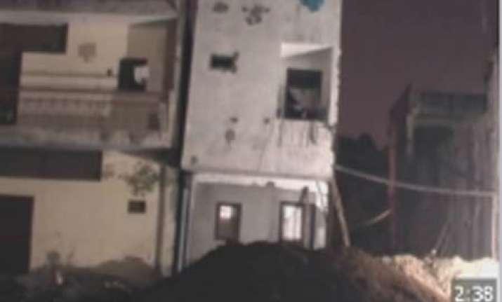 five storeyed delhi building suddenly leans residents