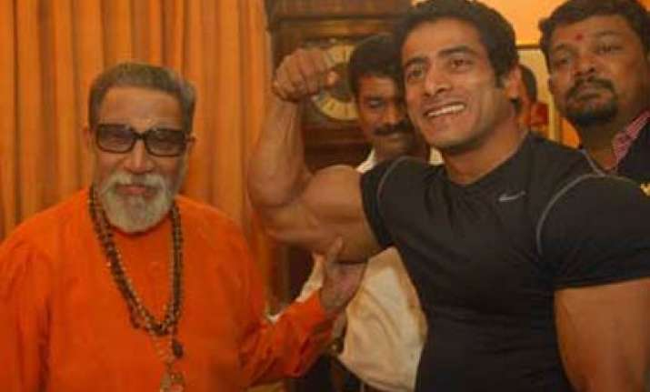 maratha bodybuilder flexes his muscles before bal thackeray