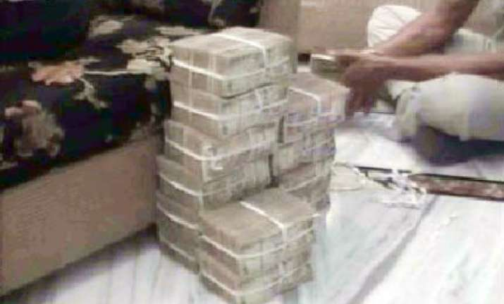 rs 1.15 crore cash seized from dairy official s residence