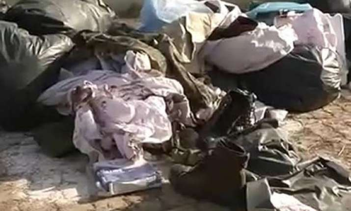 crpf orders inquiry into blood stained uniforms found in