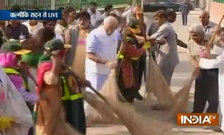 pm narendra modi wields broom as part of swachh bharat
