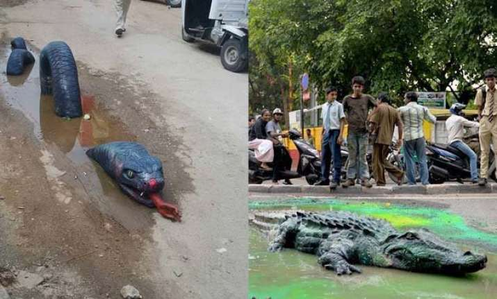 when potholes in bengaluru had an anaconda and crocodile