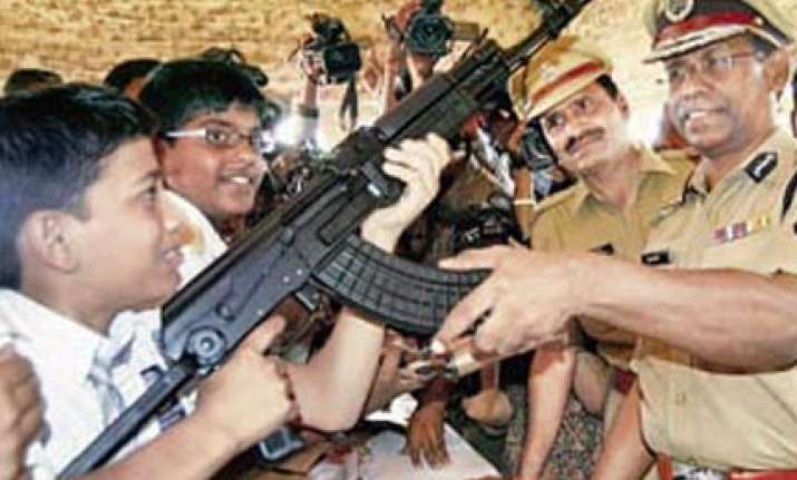 two kids killed as constable s rifle misfires