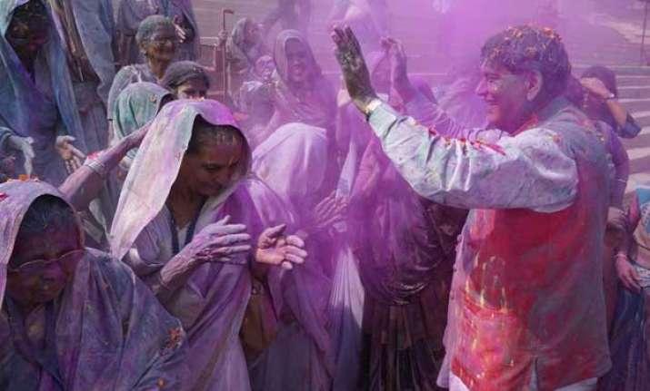 varanasi widows break tradition play holi on the banks of