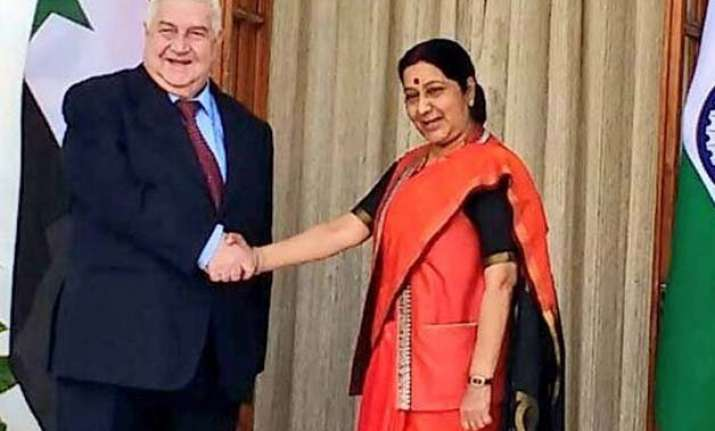 india syria hold talks on situation in the war torn country