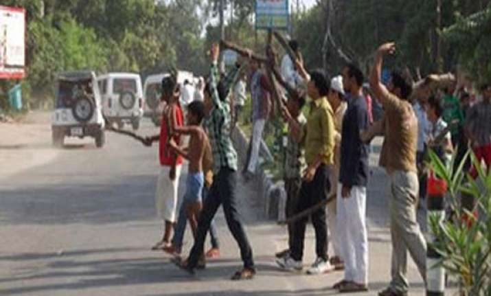 villagers pelt stones open fire at police 2 injured