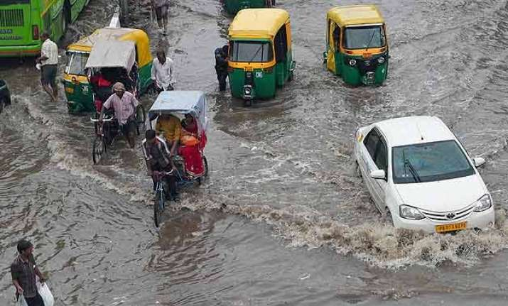heavy rains lash delhi waterlogging traffic woes for people