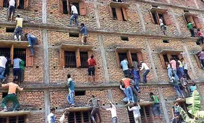 bihar exam mess over 900 held in anti cheating operation