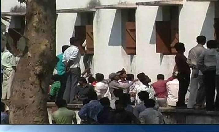 hrd ministry to seek report over cheating in exams in bihar