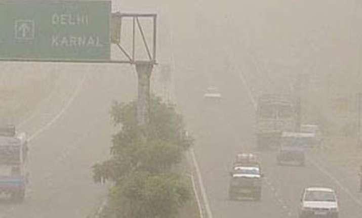 dust haze engulfs delhi temperatures climb to 34.7 c