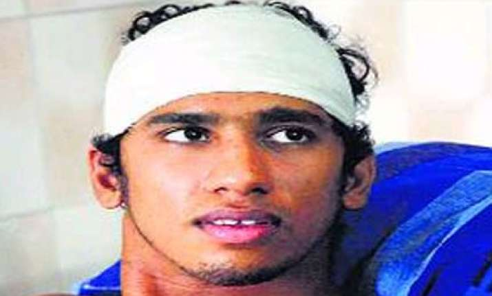 brutally beaten a month ago balakrishnan swam to the semis