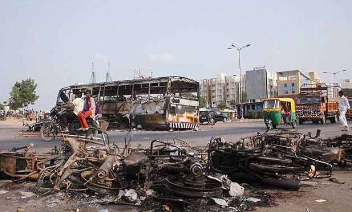 uneasy calm in violence hit gujarat toll rises to 10