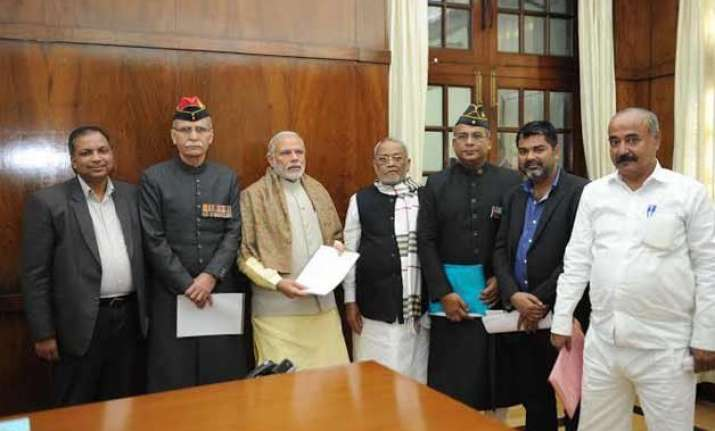amu vc meets pm modi seeks support on minority status