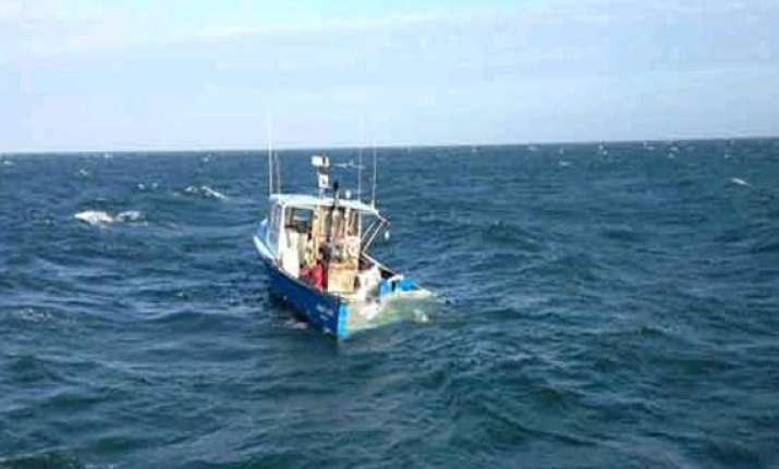 coast guard ships to rescue fishing boats from cyclone