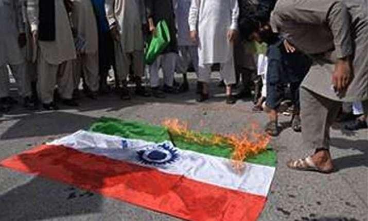 protesters burn indian flag in pok against crackdown on