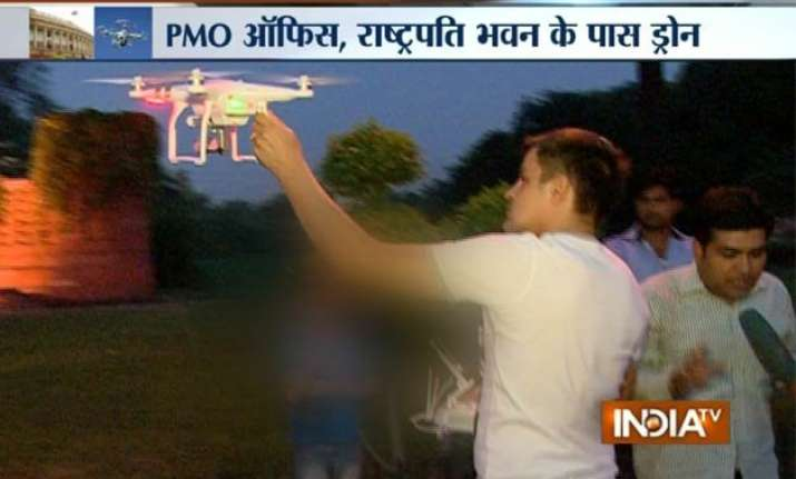 exclusive foreign national flying drone near parliament