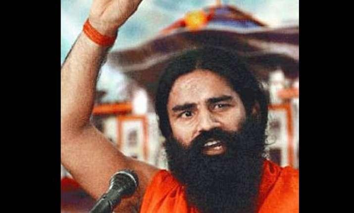 swami ramdev warns of conspiracy to defame hindu saints