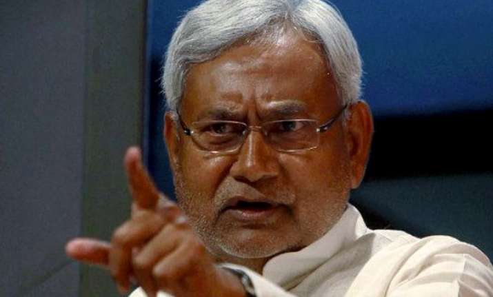 bihar will protest against cut in central funds says cm