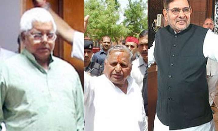 yadav trio ask pm to defer women s bill call all party meet