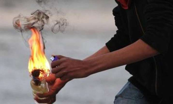 petrol bomb hurled at andhra bank no casualties