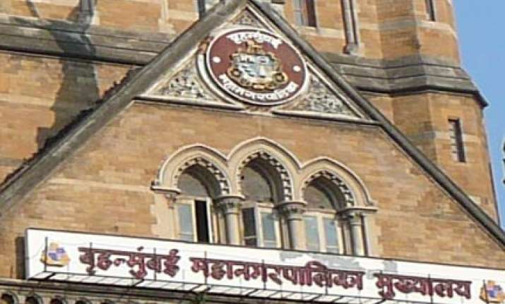bmc uses adarsh row to regain occupancy certificate powers