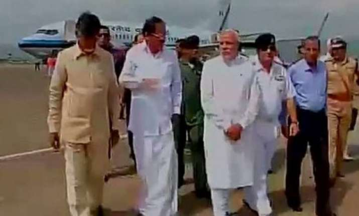 pm narendra modi arrives at vizag airport to make aerial