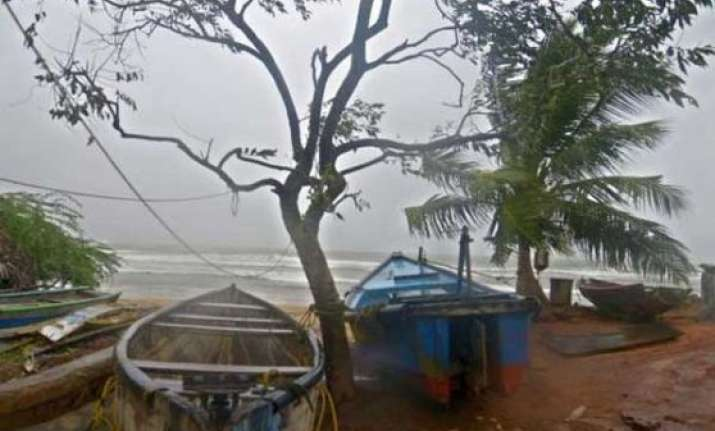cyclone hudhud makes landfall in andhra pradesh coast two