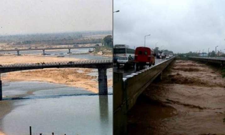 j k floods straight from the tawi bridge jammu