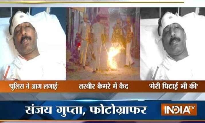 varanasi violence cops role under scanner after images show