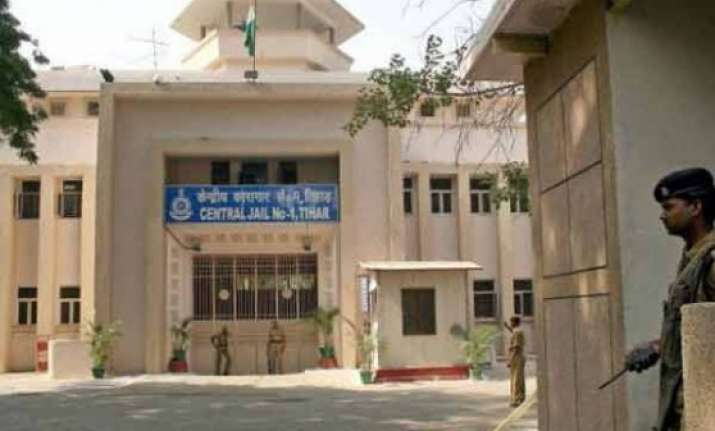 tihar jail to raise wall to stop articles being flung from