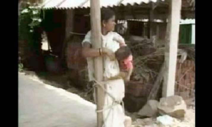 orissa villagers torture dalit woman child by tying them to