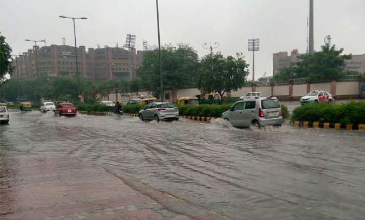 in pics live water logging due to heavy rainfall throws