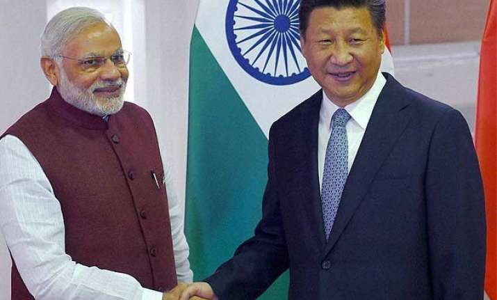 pm modi meets chinese prez xi jinping for 5th time in 1