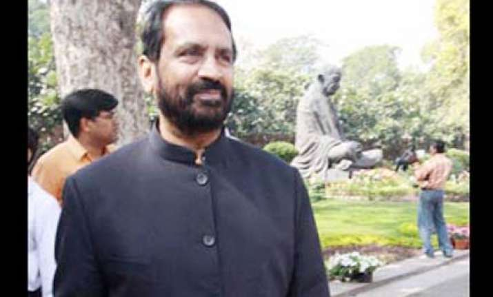 kalmadi hits back says dikshit should look at her own depts.