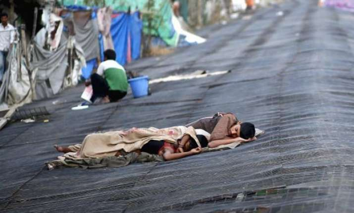india s poverty rate falls to 12.4 electricity plays big