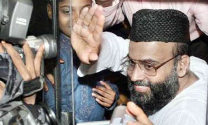madani stands isolated