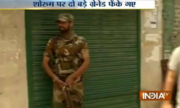 terrorists attack vodafone aircel outlets in srinagar with