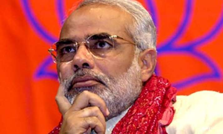 modi seeks apology from pm on pc s saffron terror remarks