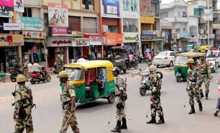 quota row tension eases curfew relaxed in violence hit