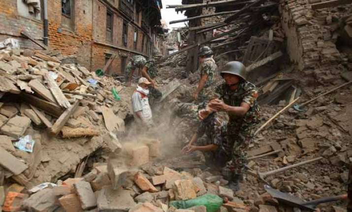nepaldevastated rescuers dig for survivors death toll