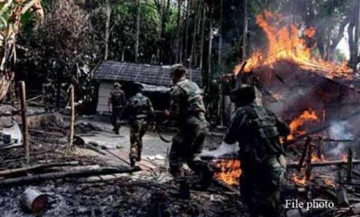 adivasis in assam retaliate kill two bodos torch a village
