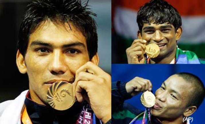 boxers paddlers keep india in hunt for second spot