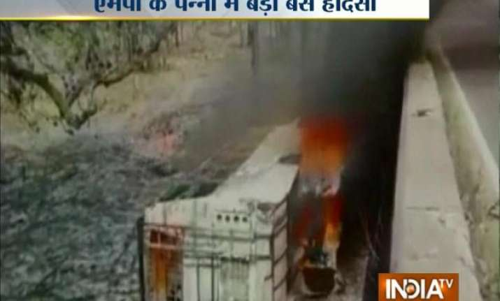 21 dead as bus falls off bridge catches fire in mp