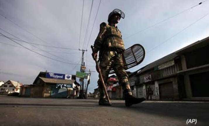 curfew imposed in four districts of kashmir