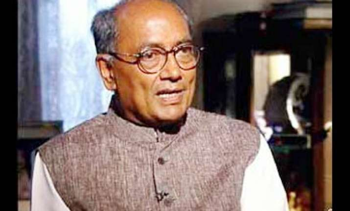 no need for kalmadi to resign says digvijay singh