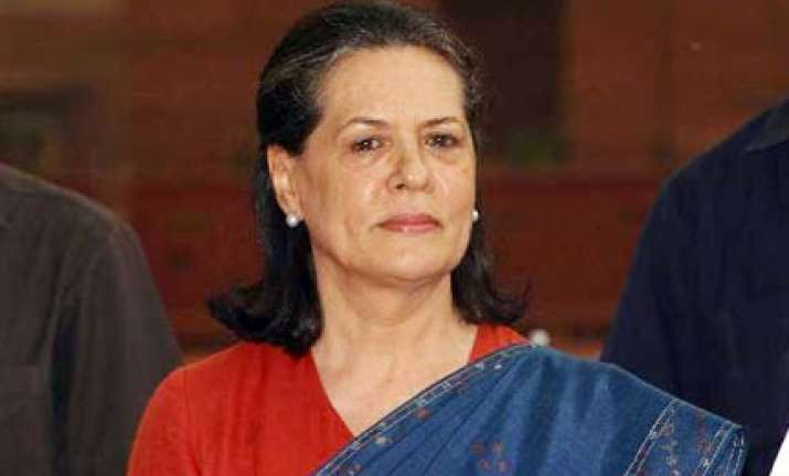 adarsh scam sonia asks pranab antony to give report