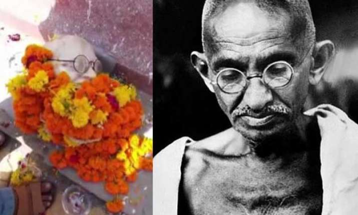 shocking head of mahatma gandhi s statue falls off during