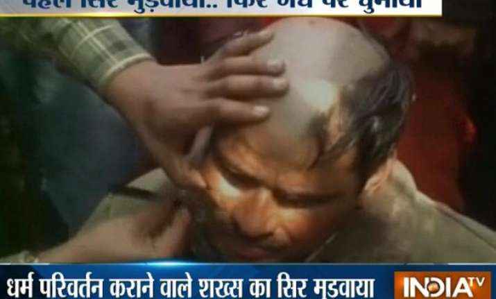 up man tonsured paraded on donkey for converting hindus to