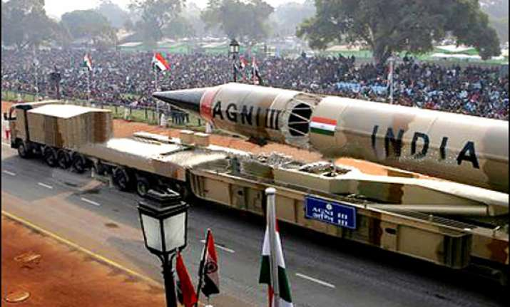 india displays its military might agni v missile at
