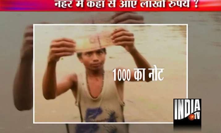 indian currency notes found floating in guwahati wetland